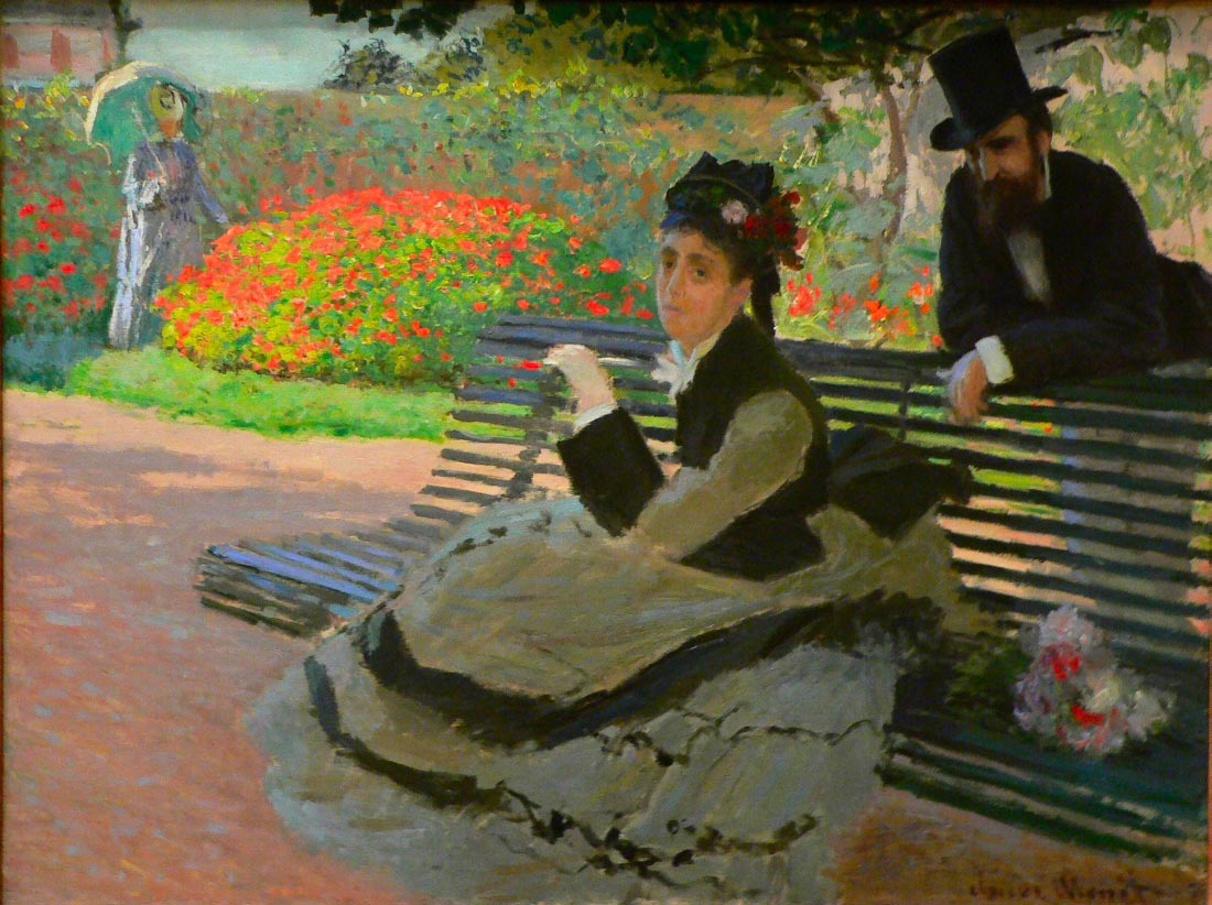 Camille Monet on a garden bench - Monet