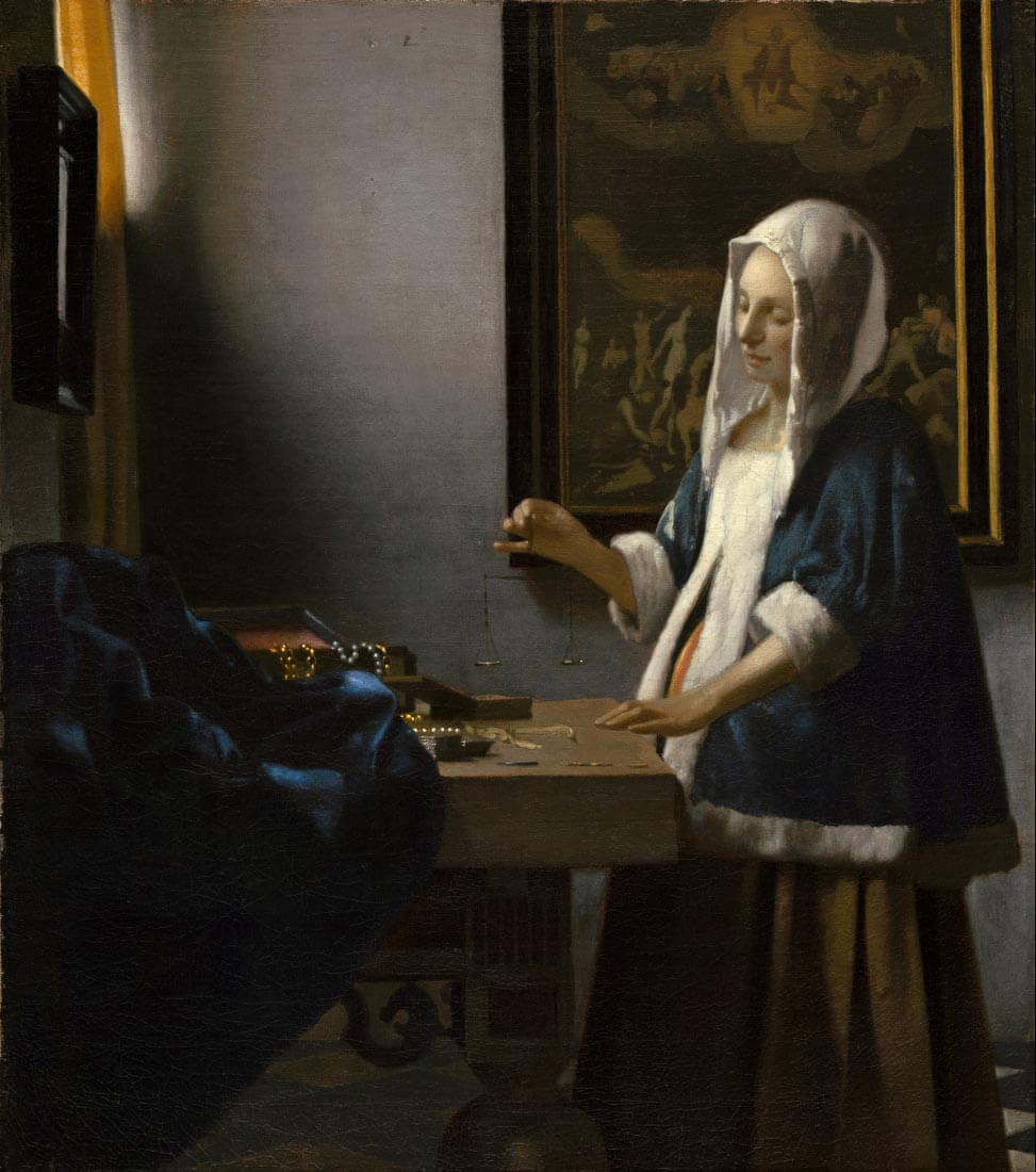 Woman holding a balance - Vermeer